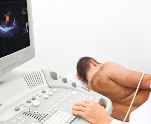 A patient undergoing a carotid ultrasound procedure and echocardiogram procedure.
